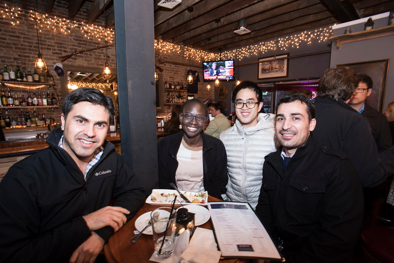 Schar School of Policy & Government students, Yerevan Saeed, Sandra Tombe, Ryan Chiu and Roj Zaell at the Spirits of '76 Restaurant in Arlington VA for a pre-Homecoming Happy Hour.  Photo by:  Ron Aira/Creative Services/George Mason University
