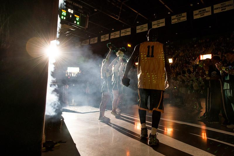 The Men's Basketball team enters Mason Madness at the Patriot Center. Photo by Alexis Glenn/Creative Services/George Mason University