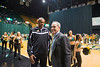 Men's basketball coach Paul Hewitt greets Dr. Ángel Cabrera at Mason Madness at the Patriot Center. Photo by Alexis Glenn/Creative Services/George Mason University