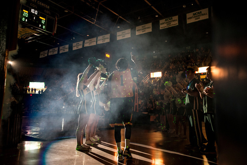 The Women's Basketball team enters Mason Madness at the Patriot Center. Photo by Alexis Glenn/Creative Services/George Mason University