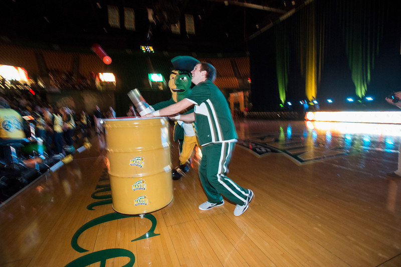 The Patriot fires rubber balls to the crowd at Mason Madness at the Patriot Center. Photo by Alexis Glenn/Creative Services/George Mason University