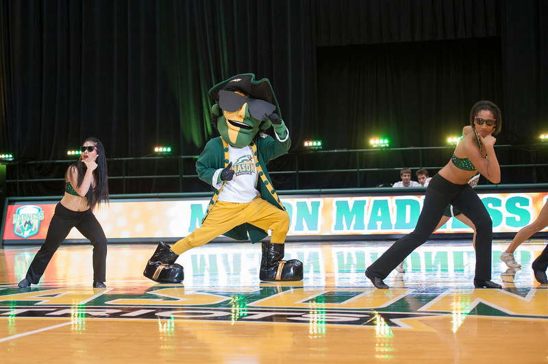 The Patriot performs with members of the Masonettes Dance Team at Mason Madness at the Patriot Center. Photo by Alexis Glenn/Creative Services/George Mason University