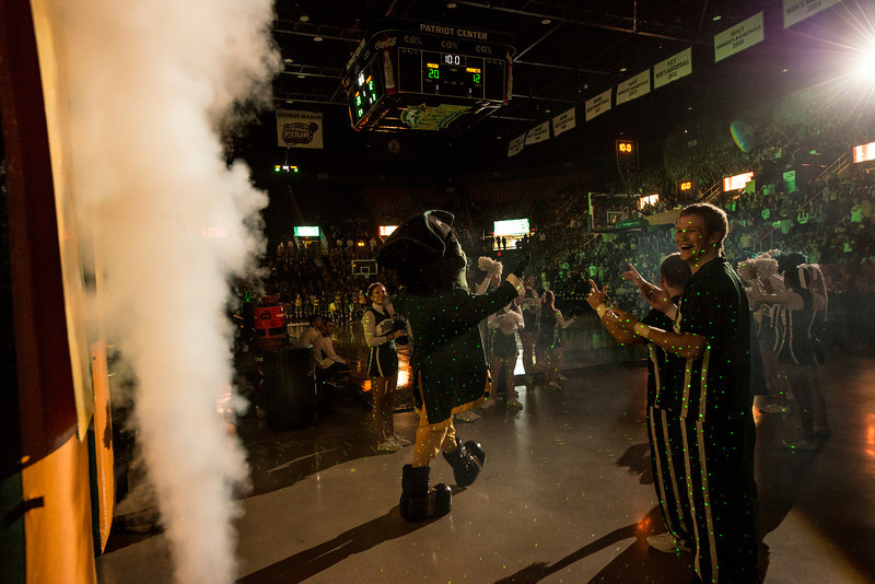Men's basketball coach Paul Hewitt, dressed as The Patriot, enters Mason Madness at the Patriot Center. Photo by Alexis Glenn/Creative Services/George Mason University