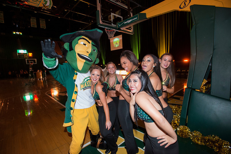 The Patriot poses with members of the Masonettes Dance Team at Mason Madness at the Patriot Center. Photo by Alexis Glenn/Creative Services/George Mason University
