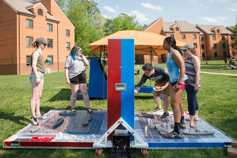 Students enjoying the warm weather at Parkapalooza in President's Park. (Bethany Camp/Creative Services/George Mason University)