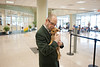 Law School Dean Daniel Polsby holds a puppy at the Law School's Puppy Day in Robert A. Levy Atrium in Hazel Hall at George Mason University's Arlington Campus. The event, part of de-stress week, is hosted by A Forever-Home Rescue Foundation and Homeward Trails, two non-profit animal rescue groups. Photo by Alexis Glenn/Creative Services