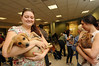 Students play with puppies at the Law School's Puppy Day in Robert A. Levy Atrium in Hazel Hall at George Mason University's Arlington Campus. The event, part of de-stress week, is hosted by A Forever-Home Rescue Foundation and Homeward Trails, two non-profit animal rescue groups. Photo by Evan Cantwell/Creative Services © George Mason University