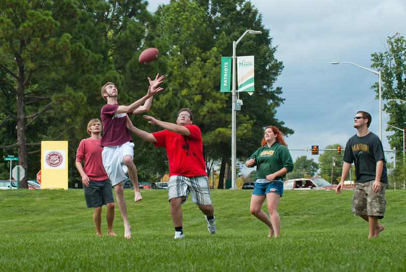 110919525 - Students enjoying a game of pick-up football on the Fairfax Campus. Photo by Alexis Glenn.