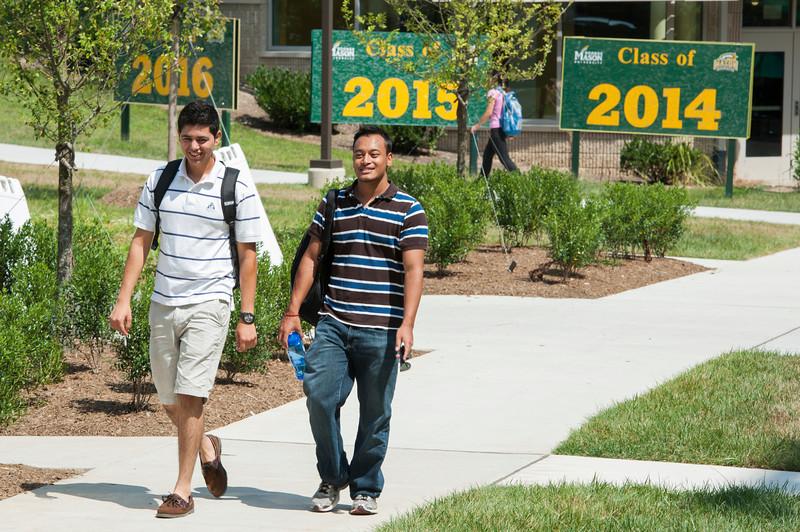 Students walk near The Hub