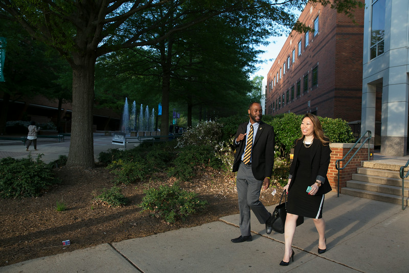 Senior Jordan Foster and alumnus Jacky Yoo walk outside of the Johnson Center. Photo by Craig Bisacre/Creative Services/George Mason University