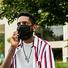 A student on a cell phone on Fairfax Campus. Photo by:  Ron Aira/Creative Services/ George Mason University