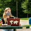 A student using a laptop outside on Fairfax Campus. Photo by:  Ron Aira/Creative Services/ George Mason University