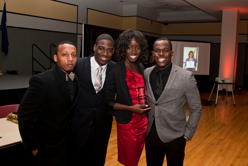Johnetta Saygbe, center, poses with members of the Alpha Phi Alpha Fraternity after being awarded the Spirit of the King Award during the Martin Luther King Evening of Reflection. Photo by Craig Bisacre/Creative Services/George Mason University