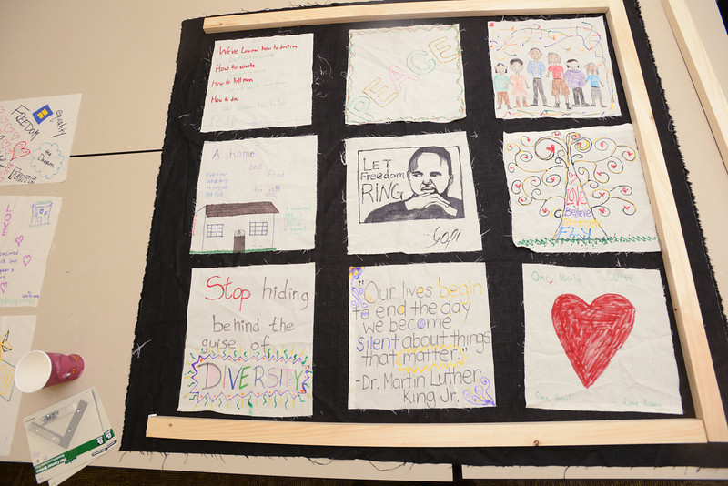During the annual commemoration of Rev. Dr. Martin Lucther King, Jr. students attend a MLK quilt making session in the Office of Diversity, Inclusion and Multicultural Education (ODIME). Photo by Evan Cantwell/Creative Services/George Mason University