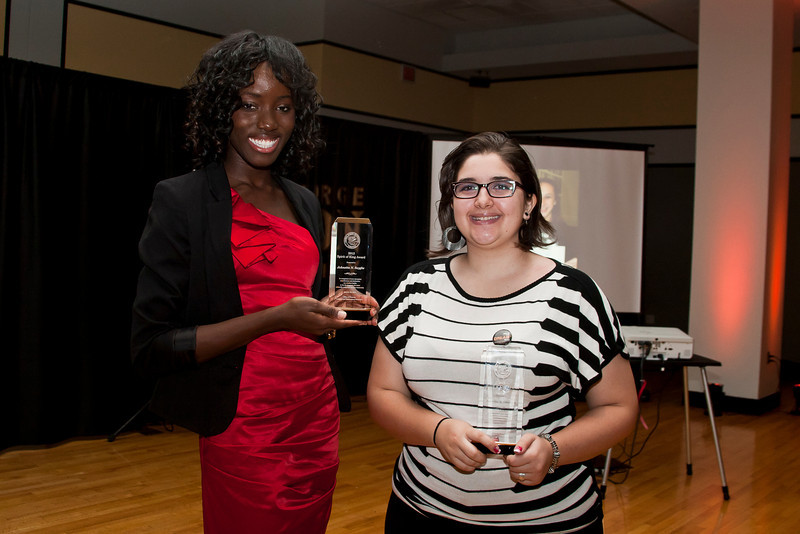 Johnetta Saygbe, left, Anartia Gamboa, right, pose for photos after being awarded the Spirit of the King Award during the Martin Luther King Evening of Reflection. Photo by Craig Bisacre/Creative Services/George Mason University