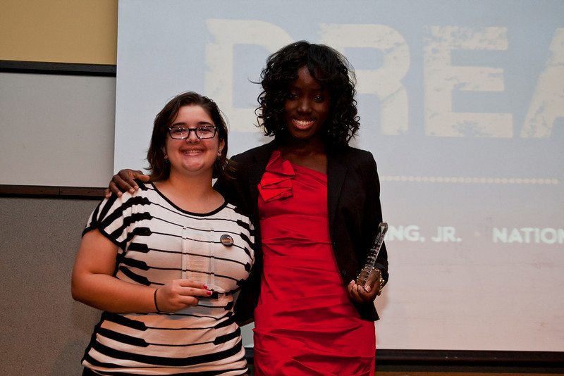 Anartia Gamboa, left, Johnetta Saygbe, right, pose for photos after being awarded the Spirit of the King Award during the Martin Luther King Evening of Reflection. Photo by Craig Bisacre/Creative Services/George Mason University