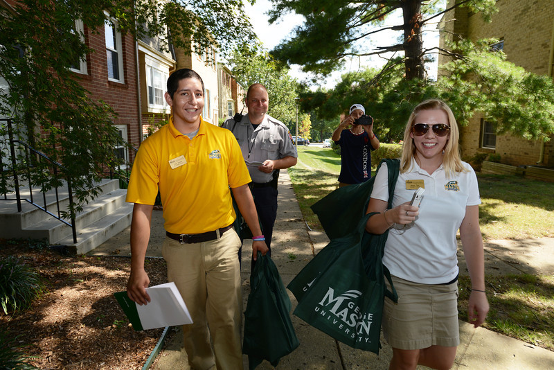 The Office of Off-Campus Student Programs and Services partners with Community Relations and the Fairfax County Police Department to welcome off campus students to the Mason community. Photo by Evan Cantwell/Creative Services/George Mason University