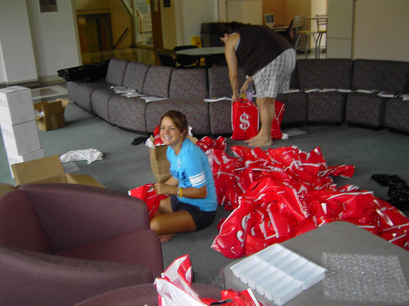 FOCUS Leaders Emily and Mary stay happy while stuffing bags for Orientation.