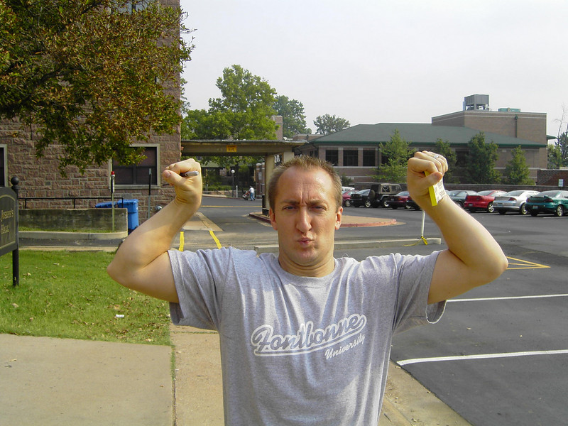 Tony Mravle, Director of Campus Ministry, shows his guns off on Move-In Day