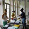 FOCUS Leaders Alex, Kim, and Ann work on the packets for the incoming freshmen.
