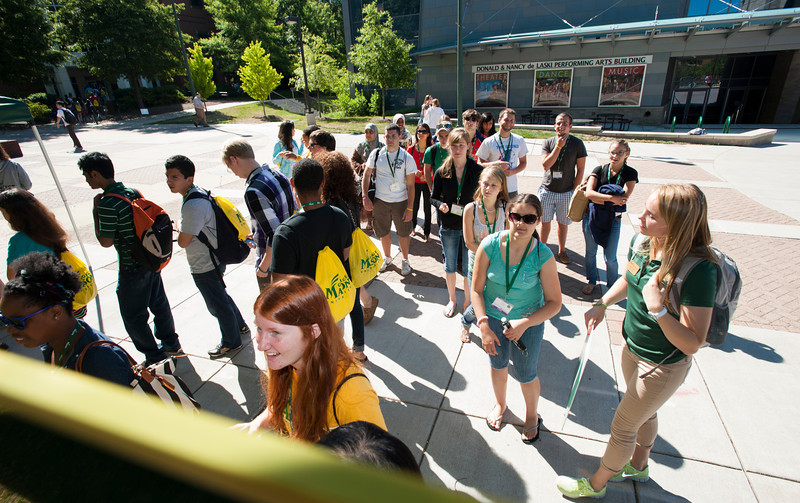 Incoming freshman students sign the 2016 board during orientation at Fairfax campus. Photo by Alexis Glenn/Creative Services/George Mason University
