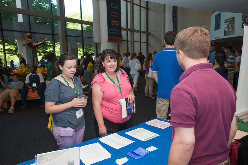 Incoming freshman students and families speak with faculty during orientation at Fairfax campus. Photo by Alexis Glenn/Creative Services/George Mason University