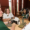 Orientation leaders Stan Heaney, Leah Quinn, and Sam Wettasinghe  eat with incoming freshman students at Southside dining during orientation. Photo by Alexis Glenn/Creative Services/George Mason University