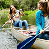 Students canoe on Thompson Bayou which runs through the University of West Florida's nature trail.