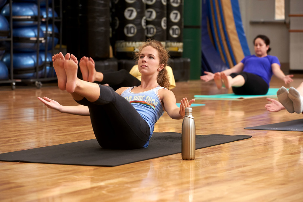 Students participate in the Hatha Yoga class in the Blue Studio at the Health Leisure and Sport Facility at the University of West Florida.