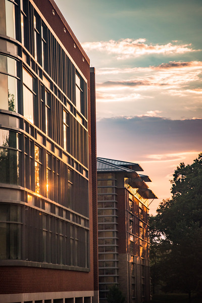 Peterson Hall and Rogers Hall, in the background, with summer clouds at sunset. Photo by Evan Cantwell/Creative Services/George Mason University