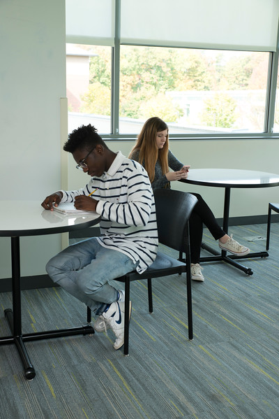 Students hang out and study in the Taylor Hall dorm common areas on the Fairfax campus. Photo by Bethany Camp/Creative Services/George Mason University