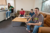 Mason students sit inside the Rogers residence hall on Fairfax campus. Photo by Alexis Glenn/Creative Services/George Mason University