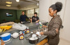 A student prepares traditional foods at Taste of the World, where different international campus organizations take over the pods in Eastern Shore residence hall and prepare a sample of a food from the culture that they represent, at Fairfax Campus.  Photo by Creative Services