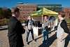 Virginia House of Delegates Representative David Bulova speaks with Senior Leslie Cook, sophomore Matthew Short, and junior Morgan Paugh, of Mason's Student Government and Academic Affairs, as students encourage voting outside Mason's polling station after they successfully requested a station on Mason's Fairfax Campus.