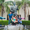 Students Steven Henriquez(left), Randi Cannon, Jacqueline Lopez, and Austin Nylander pose after partaking in the tradition of touching the statue of Dr. Hector P. Garcia's foot for good luck.
