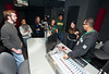 Professor Assad Kahn, who DJs part time at rock radio station DC 101, shows University 100 students the studios of the radio station in Rockville, Maryland.