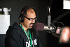 Professor Assad Kahn, who DJs part time at rock radio station DC 101,  talks on air as University 100 students tour the studios of the radio station in Rockville, Maryland.