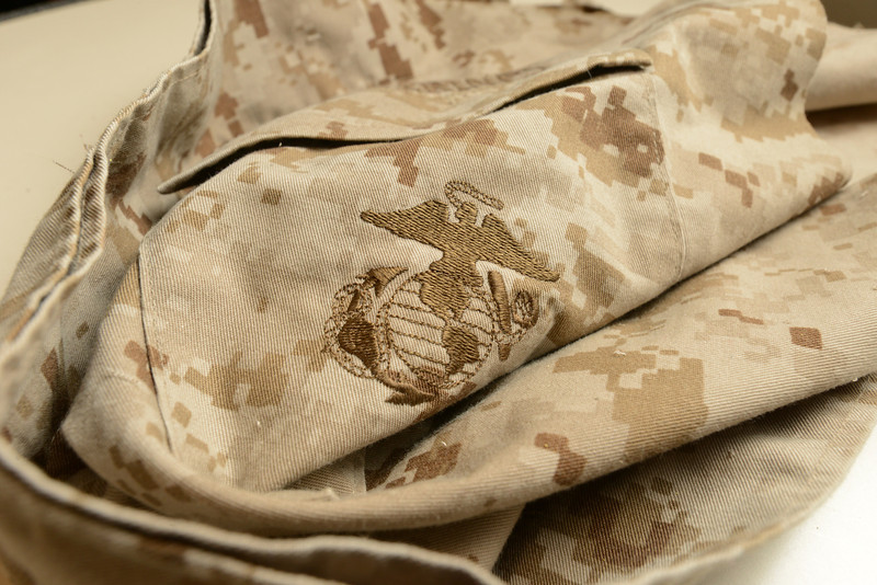 Detail of an unserviceable uniform into paper used for the veterans paper project. Photo by Evan Cantwell