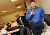 110225042e - Charvis Campbell (left), assistant dean of University Life, and Aaron Emery (right), student veteran and economics major, speak to student veterans in the Office of Military Services Transition course. Photo by Evan Cantwell