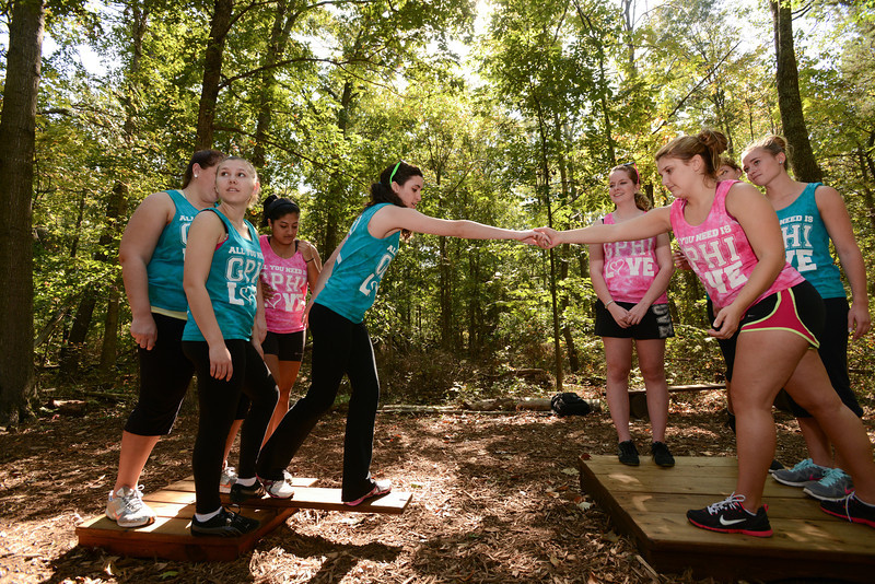 Gamma Phi Beta sisters work through challenges and teambuilding at the Edge. Photo by Evan Cantwell/Creative Services/George Mason University