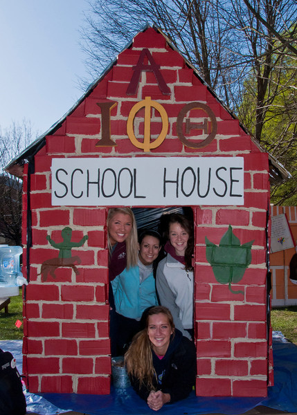 (Back row L to R) Kathlerin Gauthier, Kara Swanson, and Chelsea Lear, (Front) Terry Miller, sits inside their Sororities shack to help raise funds for Habitat for Humanity. Greek fraternities and sororities compete to build the best shack and raise money for habitat for humanity, the competition is part of the annual Greek Week.