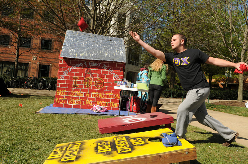 Students playing cornhole during the Greek Week Shack-A-Thon to raise money for Habitat for Humanity. Photo by Evan Cantwell/Creative Services/George Mason University