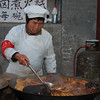 Preparing a typical outdoor meal in a Beijing Hutong