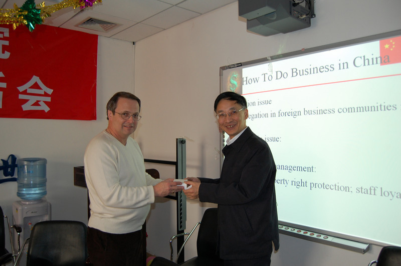 "Presentation to University professor after presenting a lecture ""How to Conduct Business in China"""