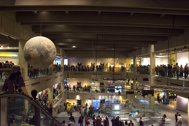 Hundreds of students move between attractions during College Night at the Museum of Science Friday evening. The event featured the museum's standard exhibits, as well as live presentations, films, and free Boston Duck Tours.