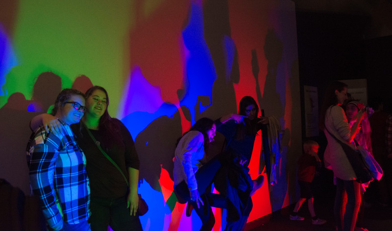 "Students pose inside of ""The Light House"", one of dozens of free attractions to college students last weekend at the Museum of Science. The exhibit, which explores the science behind light and color, is one of the museums permanent displays."