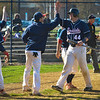Brookdale's Jon Roszel (44) is greeted with high fives after scoring a run.   The Brookdale Community College baseball team hosted and beat both Gloucester on April 24 and Harford on April 25, 2014./Russ DeSantis Photography and Video, LLC