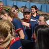 Head coach Bo Scannapieco of Brookdale talks to his team between innings. The Brookdale Community College softball team beat Ocean County College in the morning game of the Region XIX softball tournament held at Middlesex County College in Edison on Saturday, May 3, 2014./Russ DeSantis Photography and Video, LLC