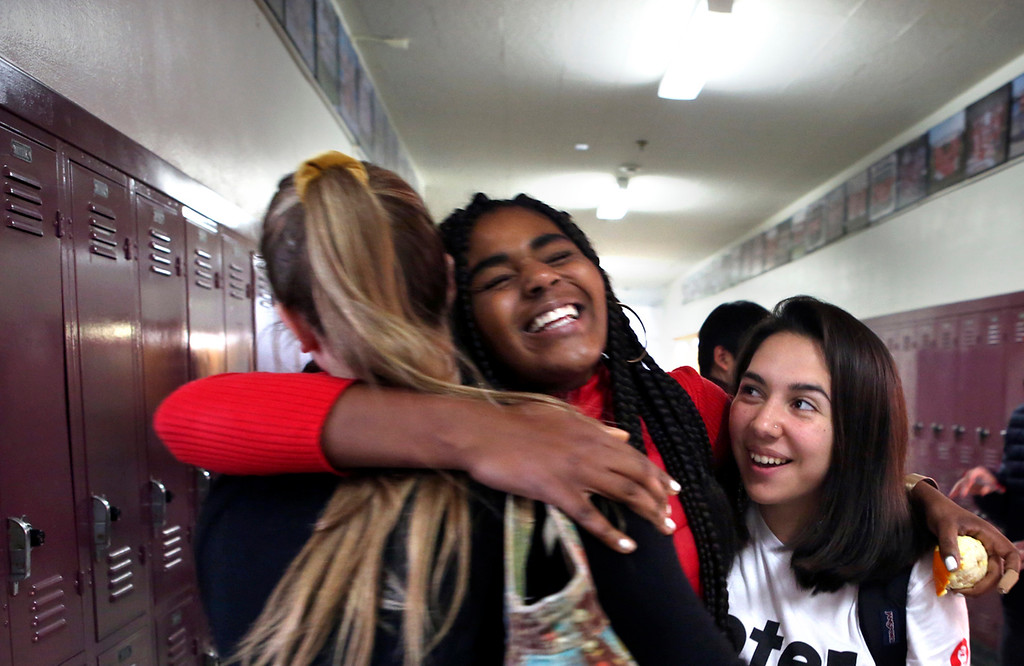 . Santa Cruz High freshman Carmen Azmitia is embraced by fellow students Lillian Greene and Daniela Werlin-Martinez after Azmitia spoke at Wednesday\'s rally at the school protesting gun violence. (Shmuel Thaler -- Santa Cruz Sentinel)