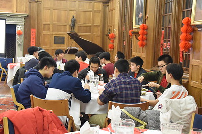 Students celebrating Lunar New Year with traditional dinner in Hinkle Room